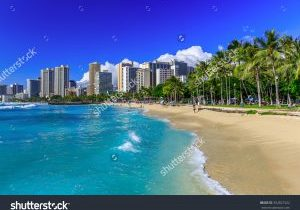 stock-photo-honolulu-hawaii-waikiki-beach-and-honolulu-s-skyline-352827422
